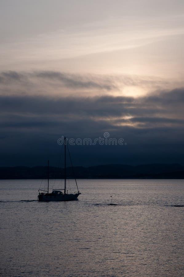 Sailboat in dark sunset #2 stock photography