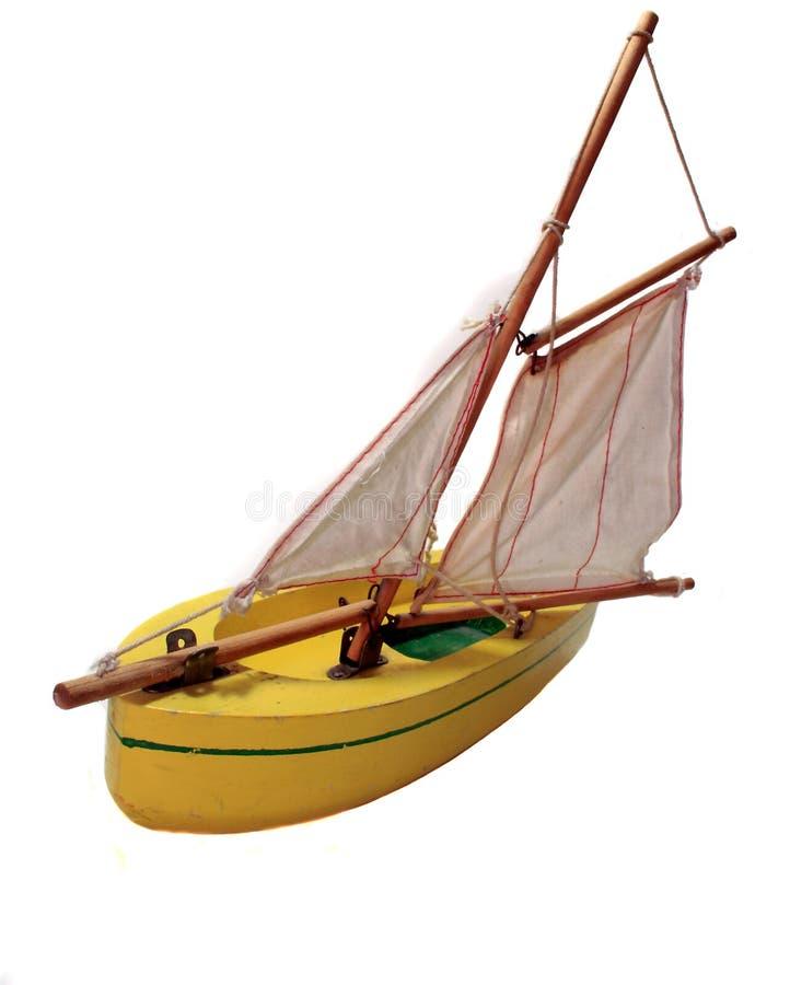 Sailboat de madeira amarelo do brinquedo imagem de stock
