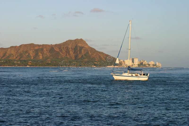 Sailboat and Diamond Head in Waikiki Hawaii stock photography