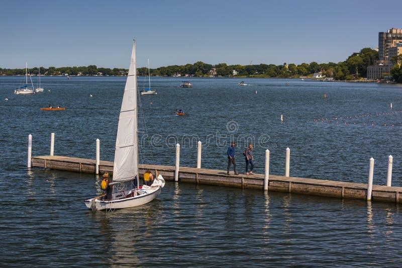 Sailboat docking on Lake Mendota, Madison, Wisconsin. royalty free stock photo