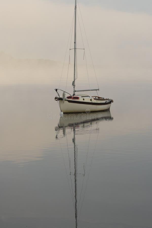 Sailboat on Foggy Morning royalty free stock photography