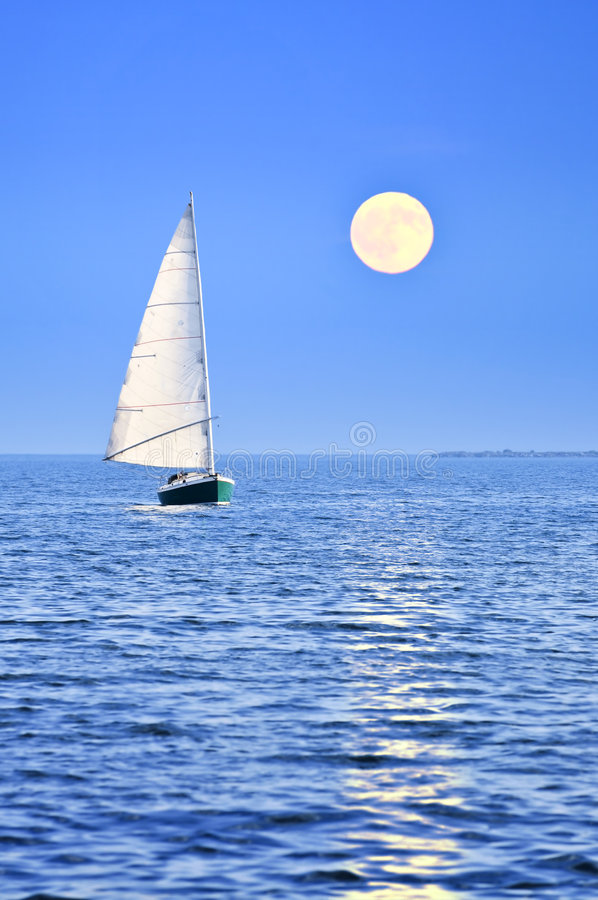 Sailboat at full moon