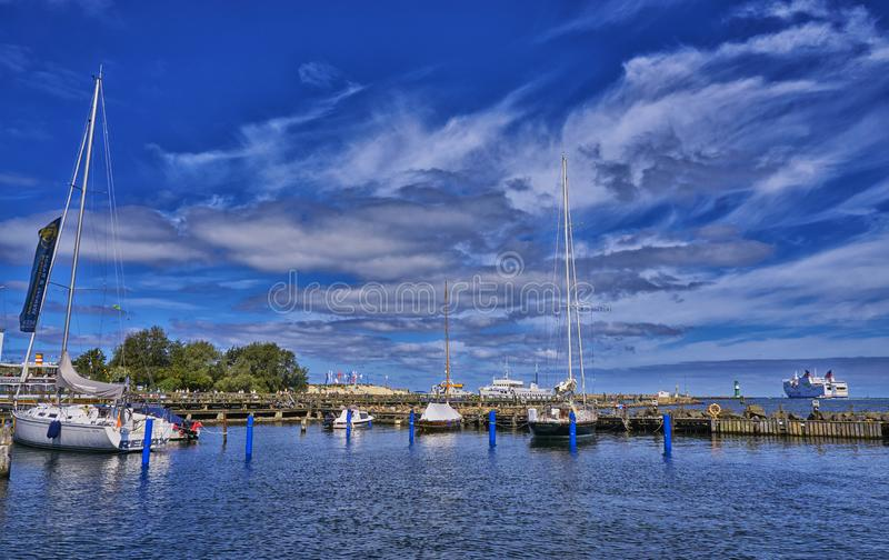 Sailboat harbor, many beautiful moored sail yachts in the sea port, modern water transport, summertime vacation, luxury lifestyle. And wealth concept. Warnem stock photography