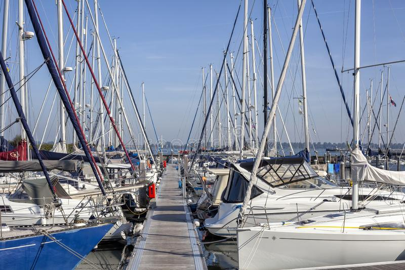 Sailboat harbor, many beautiful moored sail yachts in the sea port, modern water transport, summertime vacation, luxury lifestyle stock image