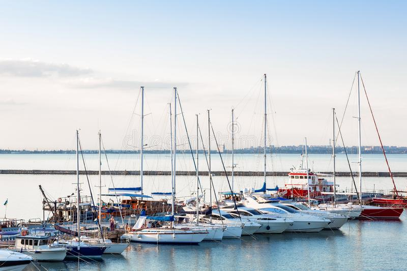 Sailboat harbor, many beautiful moored sail yachts in the sea port, modern water transport, summertime vacation, luxury lifestyle royalty free stock photos