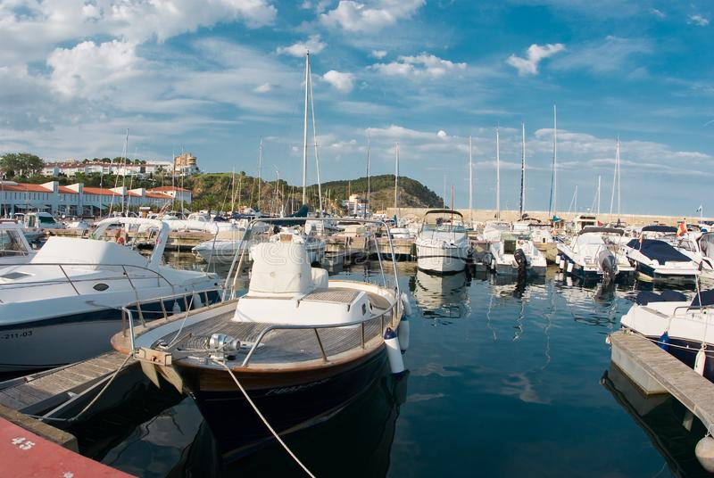 Sailboat harbor, many beautiful moored sail yachts in the sea port, summertime vacation stock images