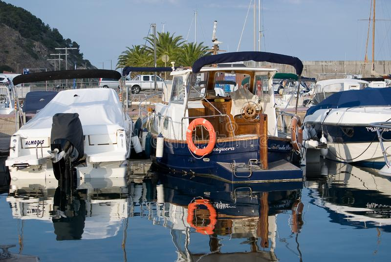 Sailboat harbor, many beautiful moored sail yachts in the sea port, summertime vacation. Calm stock image