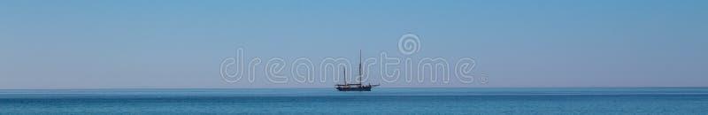 Sailboat on the horizon panorama royalty free stock image