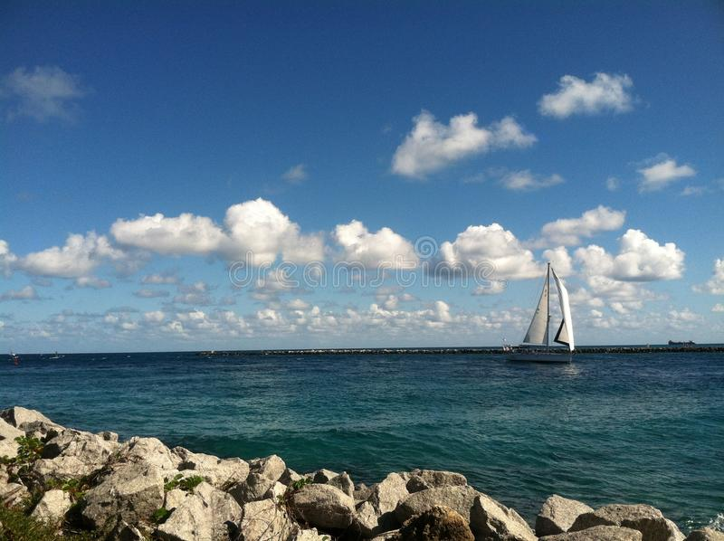 Sailboat in the inlet stock image