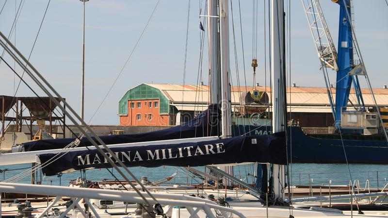 Sailboat of the Italian Navy anchored at the dock of the port of stock images