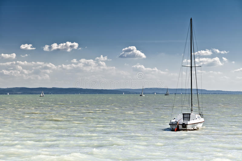 Sailboat on the lake royalty free stock photography