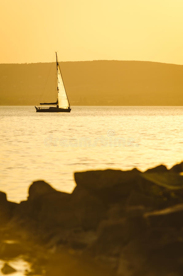 Sailboat on lake royalty free stock photography