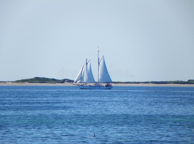 Sailboat leaving Provincetown Cape Cod royalty free stock photos