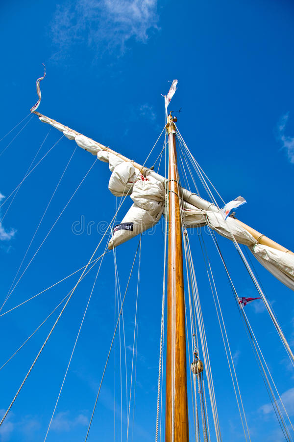 Sailboat mast. In bright blue sky royalty free stock images