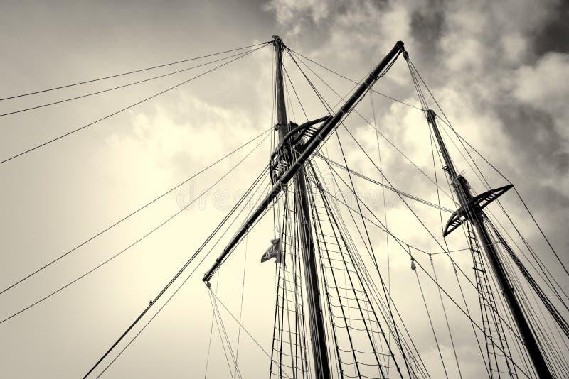 Sailboat masts. Low angle take of sailboat masts and rigging stock image