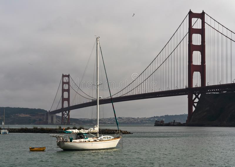 Sailboat moored near the Golden Gate Bridge royalty free stock images