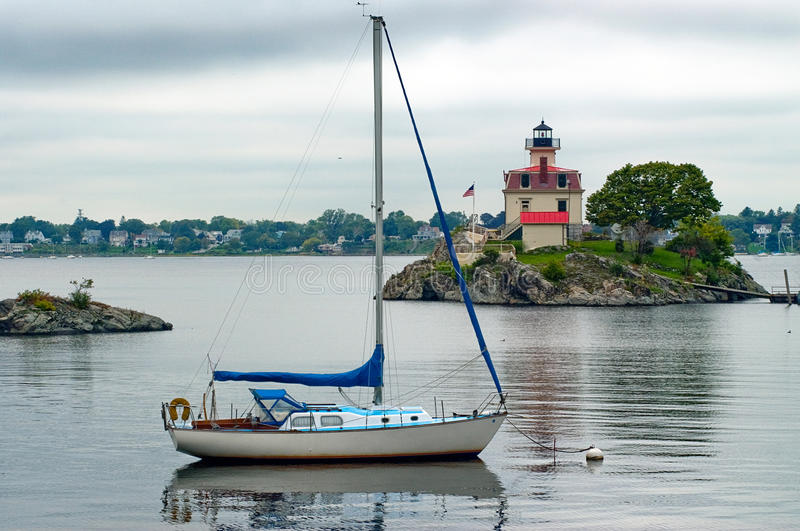 Sailboat Moored Near Lighthouse in Providence Rhode Island royalty free stock images