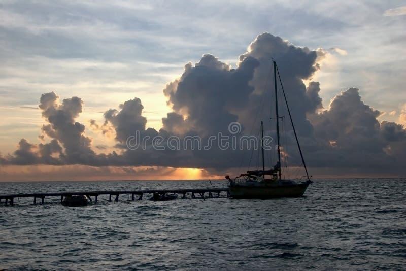 Sailboat moored at sunset royalty free stock photo
