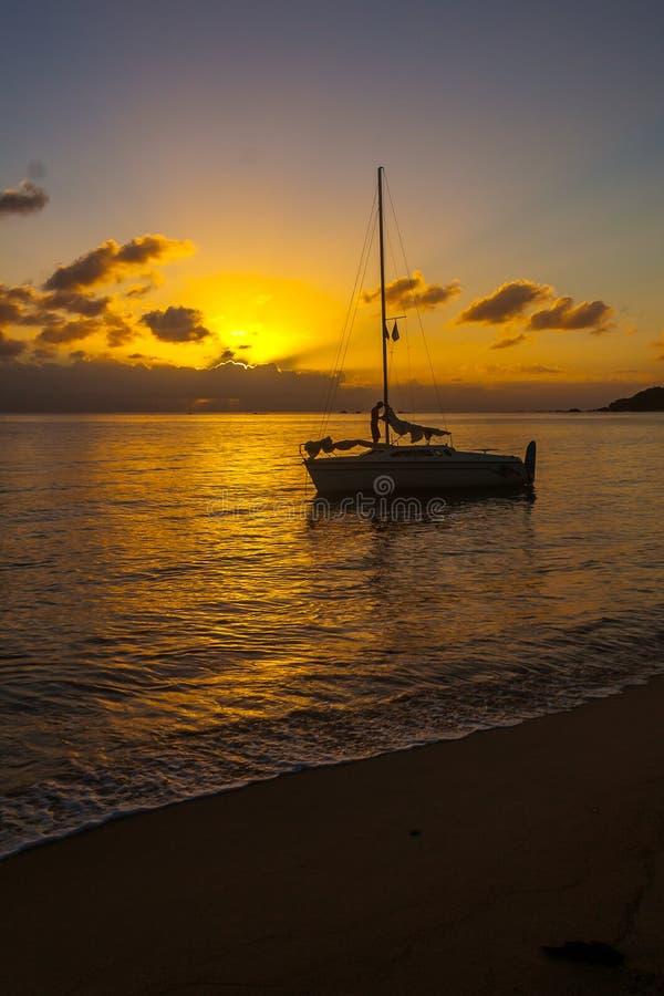 Sailboat mooring. At sunset in Antongil bay, Madagascar, africa, anchor, antalavia, beach, beautiful, blue, coast, cruise, dusk, evening, journey, lagoon royalty free stock photo