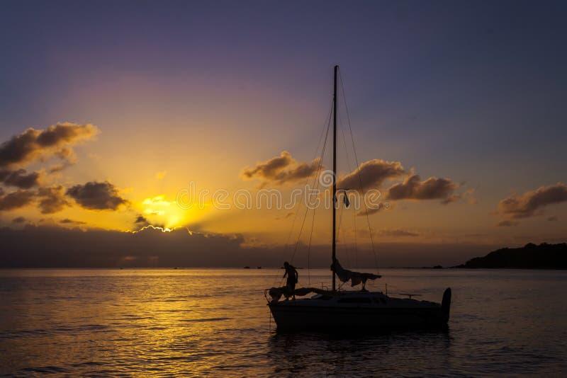 Sailboat mooring. At sunset in Antongil bay, Madagascar, africa, anchor, antalavia, beach, beautiful, blue, coast, cruise, dusk, evening, journey, lagoon stock photos
