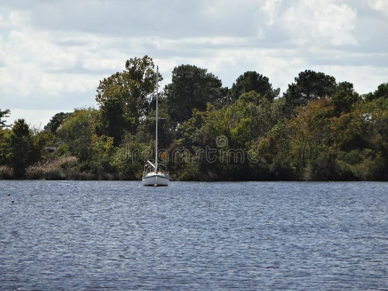 Sailboat in New Bern, North Carolina. A single sail boat is anchored in New Bern, North Carolina royalty free stock images