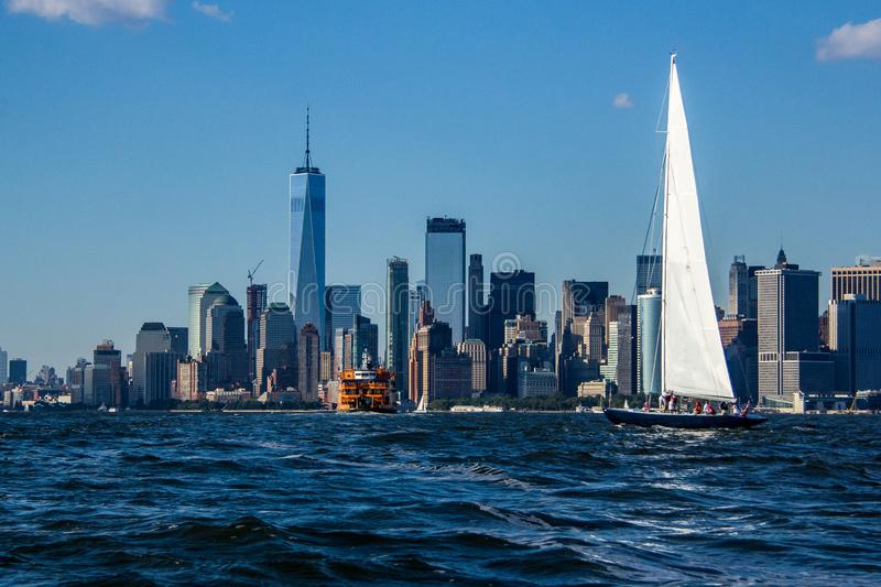 Sailboat in New York City Harbor stock images