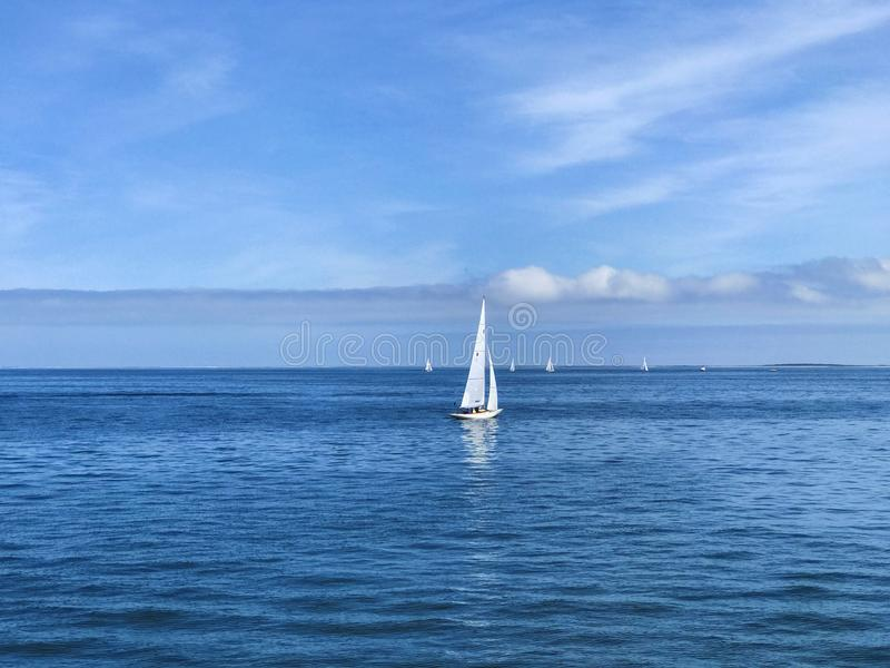 Sailboat in Open Water. Sailboat on a clear day, sailing in open water royalty free stock photo