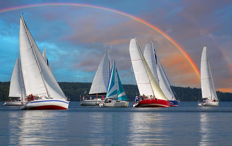 Sailboat Rainbow.Sailboat sail off into the sunset on Lake. stock image