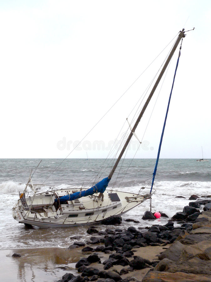 Sailboat On The Rocks Royalty Free Stock Photo