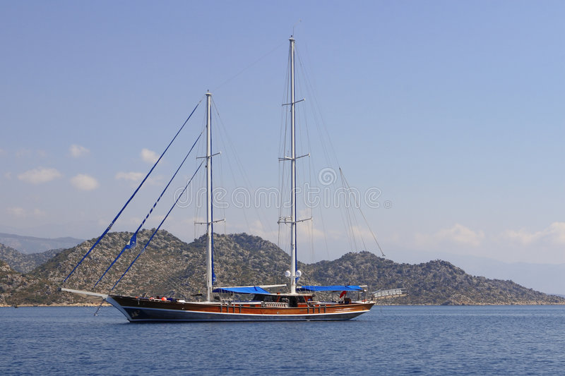 Sailboat without sail stock photography