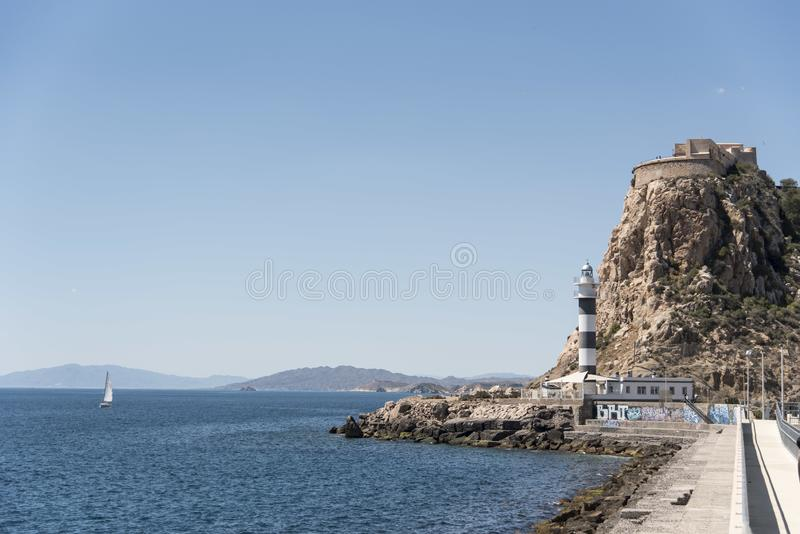 Sailboat sailing next to the Aguilas lighthouse in Spain stock photos