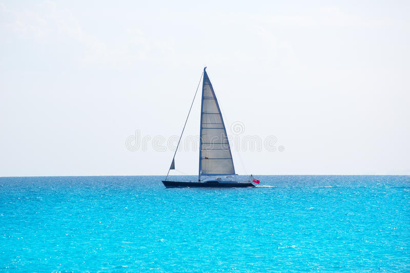 Sailboat sailing in balearic islands turquoise Mediterranean royalty free stock photography