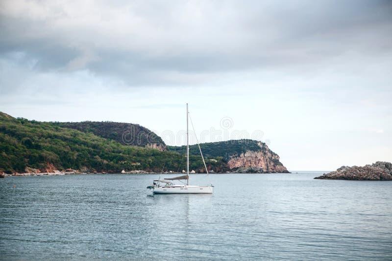 Sailboat or sailing boat. In the sea near the coast royalty free stock photo