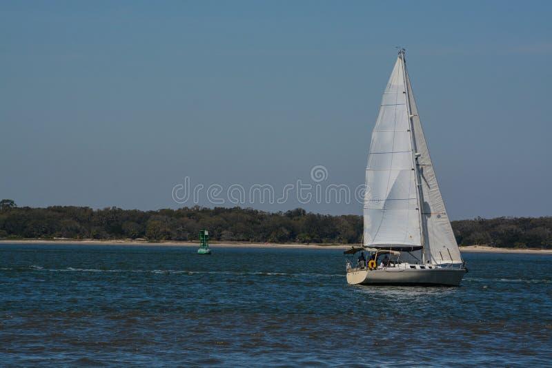 Sailboat sailing on Cumberland Sound. Fernandina Beach, Nassau County, Florida USA.  stock photo