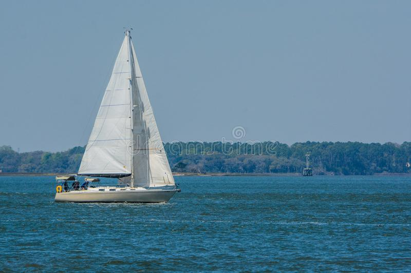 Sailboat sailing on Cumberland Sound. Fernandina Beach, Nassau County, Florida USA.  royalty free stock photo