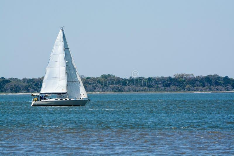 Sailboat sailing on Cumberland Sound. Fernandina Beach, Nassau County, Florida USA.  royalty free stock images