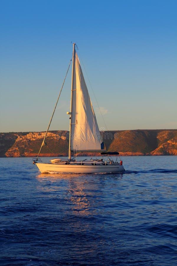 Download Sailboat Sailing Golden Sunrise In Blue Ocean Stock Image - Image: 16825091