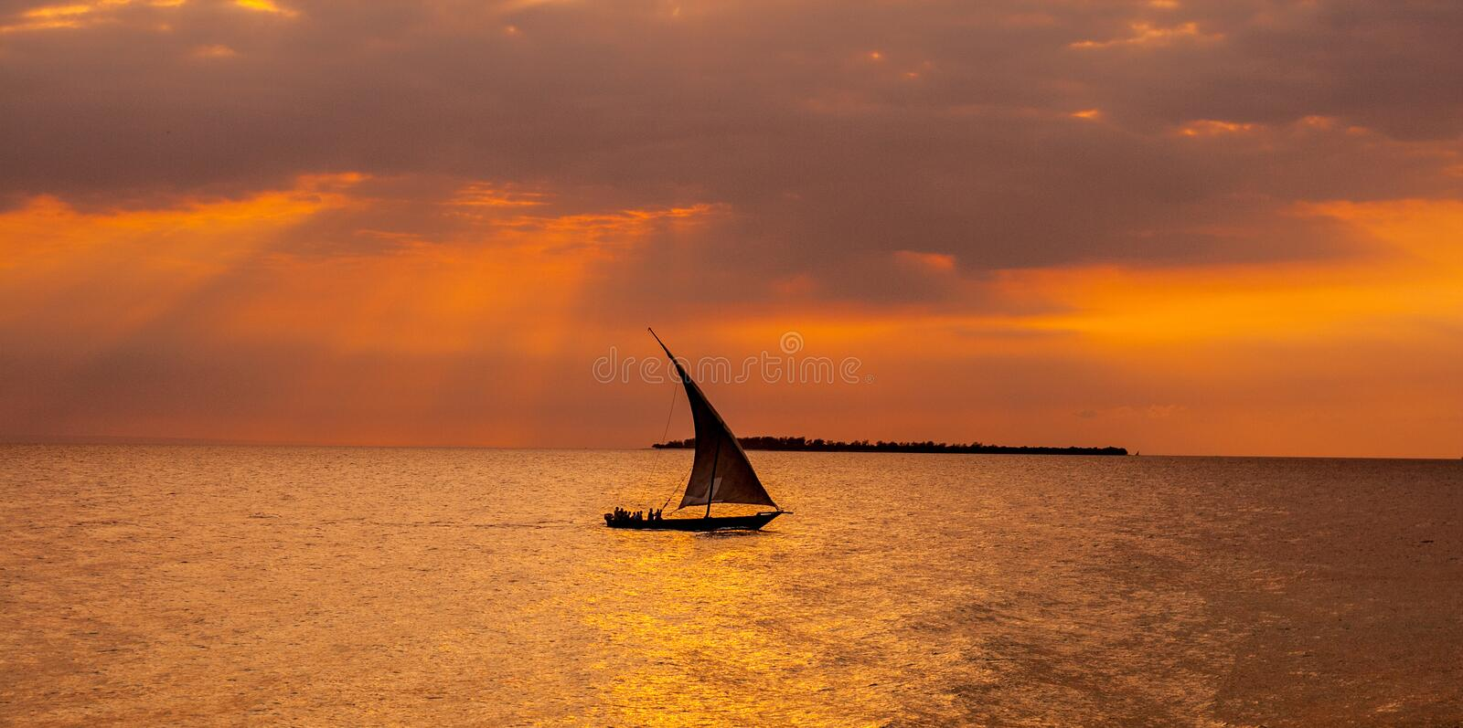 Sailboat sailing in the sunset royalty free stock images
