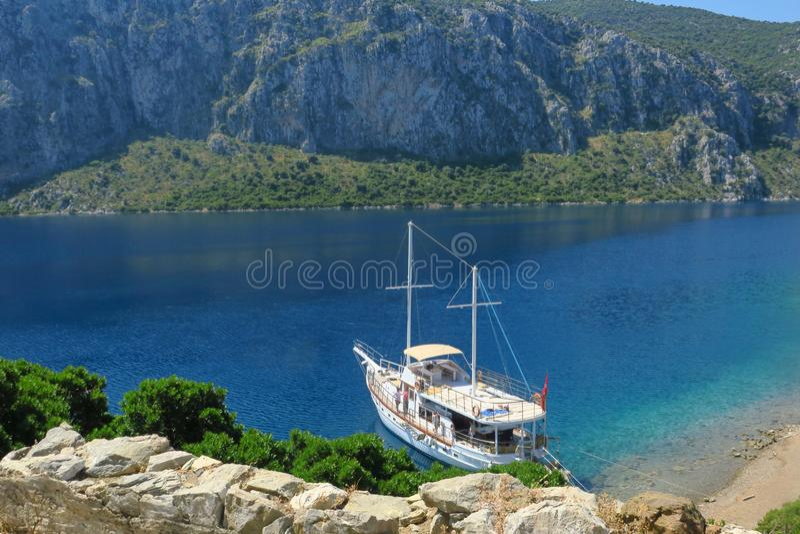 Sailboat in the sea near the coastline , yacht near the coast of Turkey royalty free stock photos