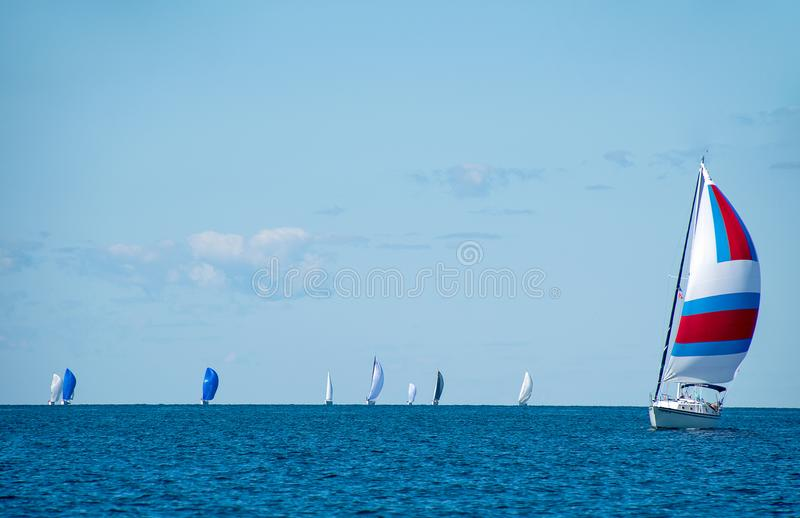 Sailboat with spinnaker on Lake Michigan. Sailboats with spinnakers in boating race on Lake Michigan royalty free stock photos