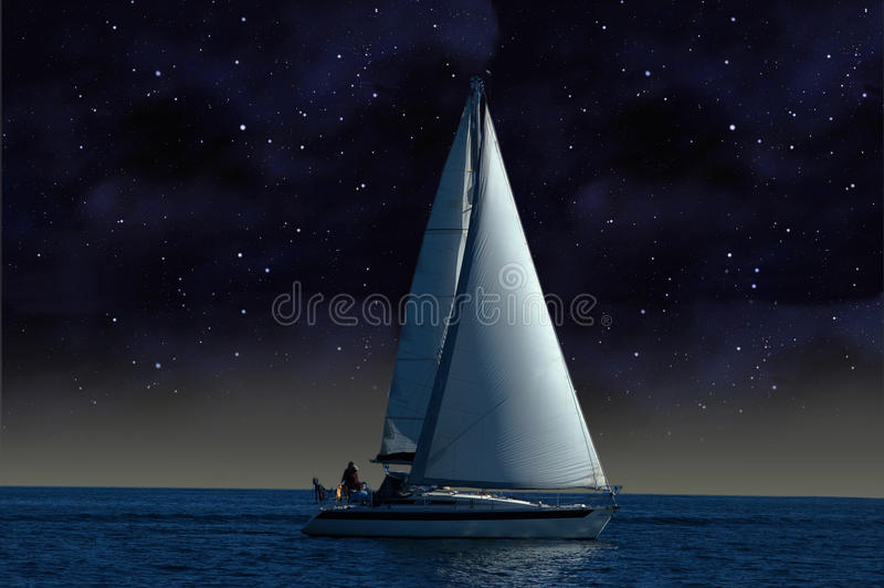 A sailboat in the starry night royalty free stock images