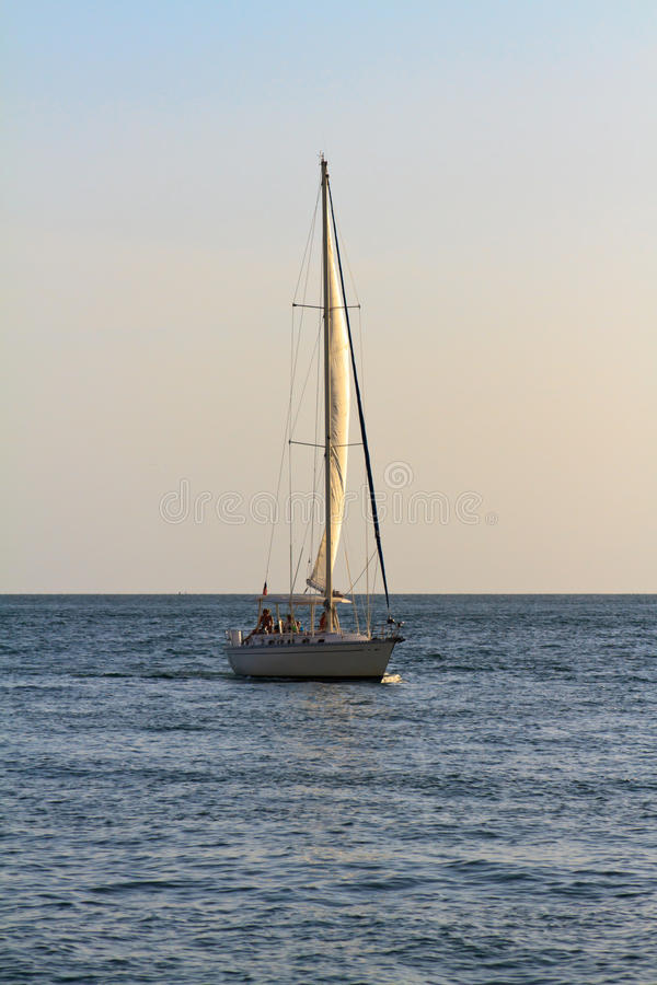 Download Sailboat at sunset stock image. Image of relaxation, tropical - 21182247