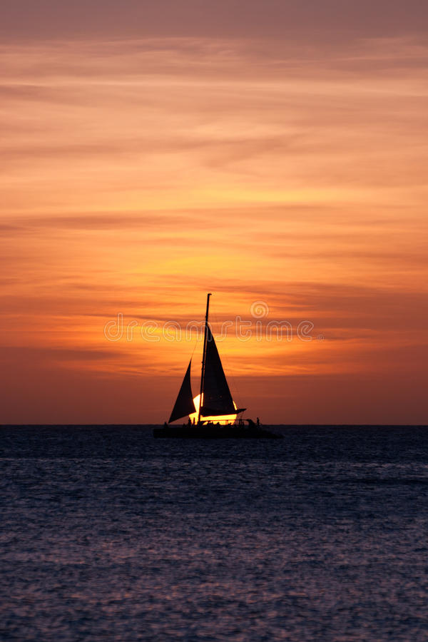 Download Sailboat at sunset stock photo. Image of yellow, sunset - 25523196