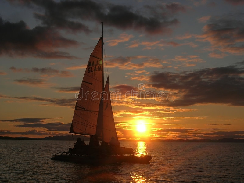 Download Sailboat at sunset stock photo. Image of colorful, clouds - 6187956