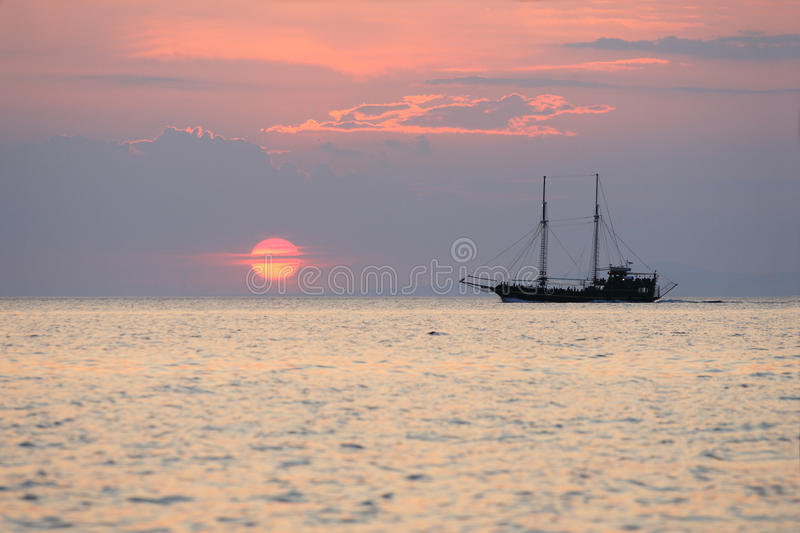 Sailboat During Sunset Above The Sea Royalty Free Stock Photos