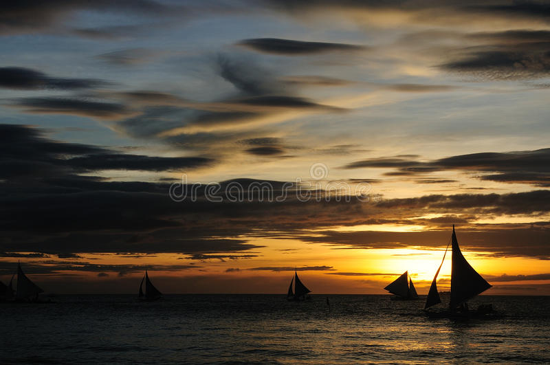 Sailboat on the sunset background. stock photos