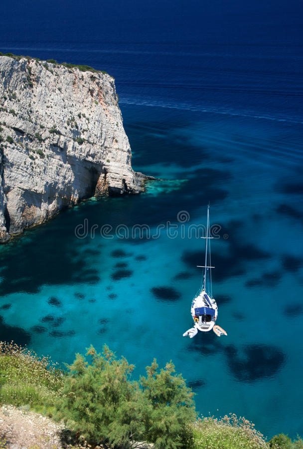 Sailboat in turquoise lagoon