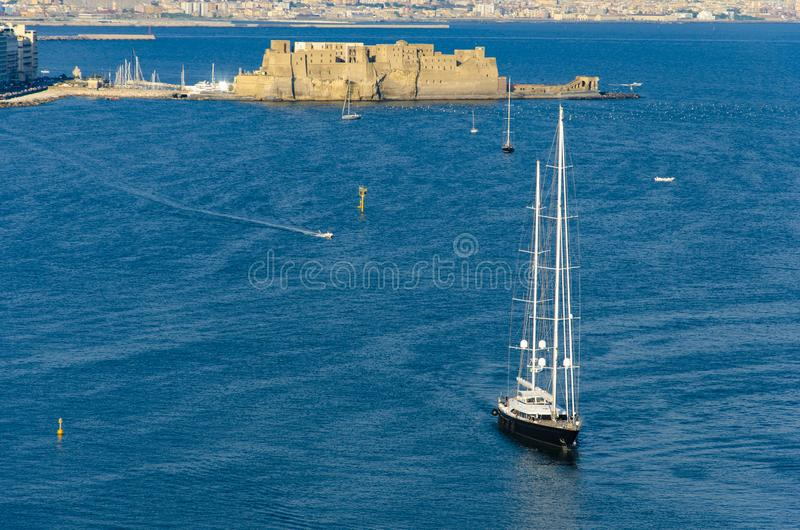 Sailboat at Tyrrhenian sea and Egg castle on background in Naples, Italy. stock image