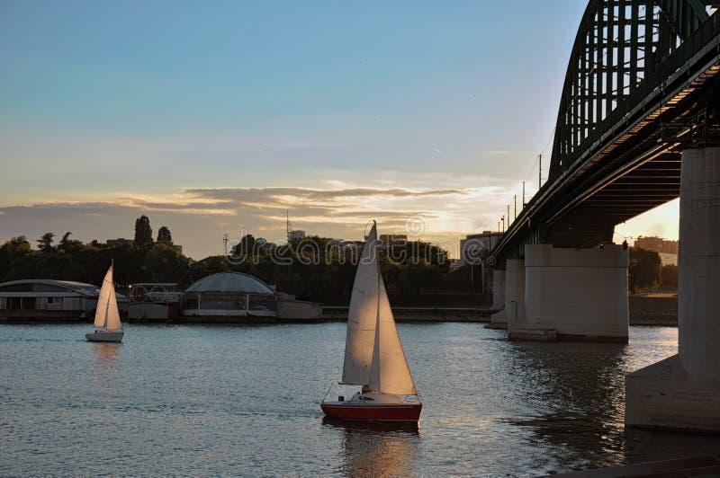 Sailboat under the bridge stock image
