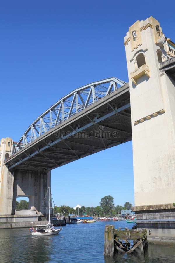 Sailboat Under Burrard Street Bridge, Vancouver royalty free stock photo